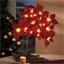 Boom met kerststerren en leds