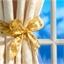 4 goldene Geschenkband-Rollen