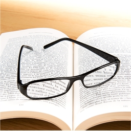 Black magnifying spectacles