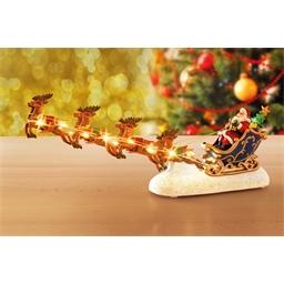 Leuchtende Rentiere mit Weihnachtsmann