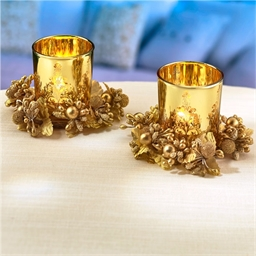 2 gold candleholders