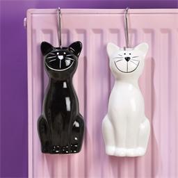 2 luchtbevochtigers zwarte en witte kat