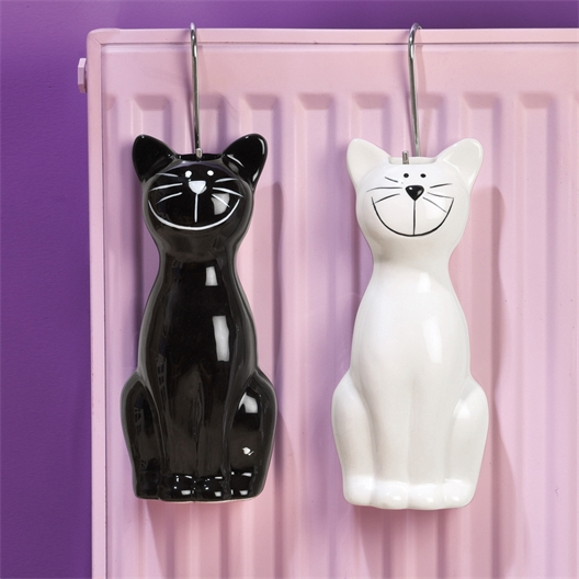 2 black + white cat humidifiers