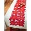 Tafelloper met uitgesneden kerststerren